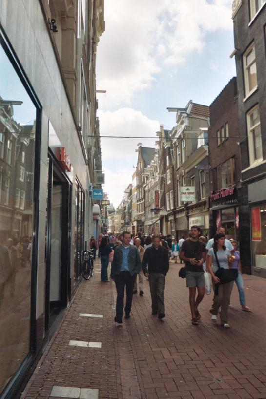 People walk down Kalverstraat in Amsterdam, Netherlands.