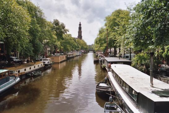 Amsterdam's canals flow through the city.