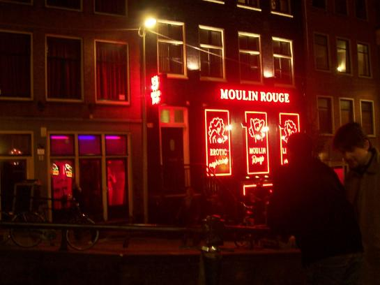 Women stand in windows in Amsterdam's red light district.