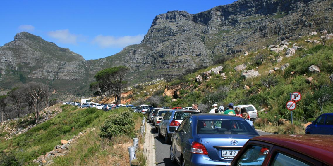 Vacationers wait in traffic near Table Mountain in Cape Town, South Africa.