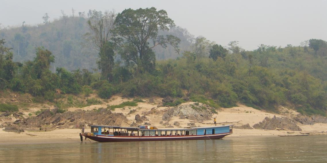 One of the infamous slow boats makes its way down the Mekong