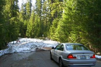 My car sits, terrified, in front of a snowdrift in the Gifford Pinchot National Forest