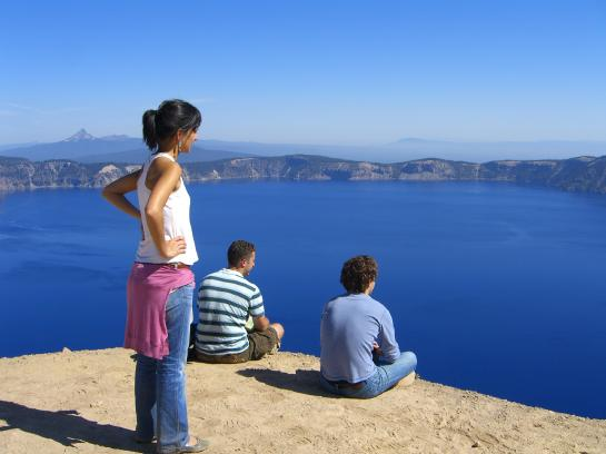 Beatrice, Hank, and Brian gaze at Crater Lake.