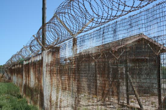 A barbed wire fence guards the prison on Robben Island near Cape Town, South Africa.