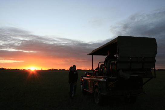 The sun sets over our Land Rover on our final day in Botswana.