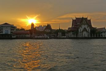 The sun sets over the Chao Phraya River in Bangkok
