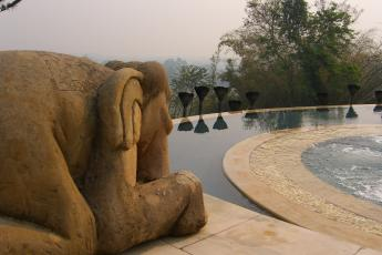 A stone elephant in the infinity pool at the Anantara Resort in the Golden Triangle in Thailand