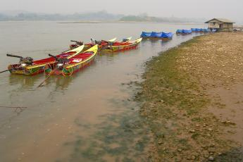 Speed boats on the Mekong River in Huay Xai, Laos