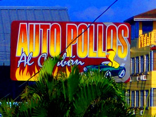 The sign for the Auto Pollos al Carb�n restaurant in Tela, Honduras.