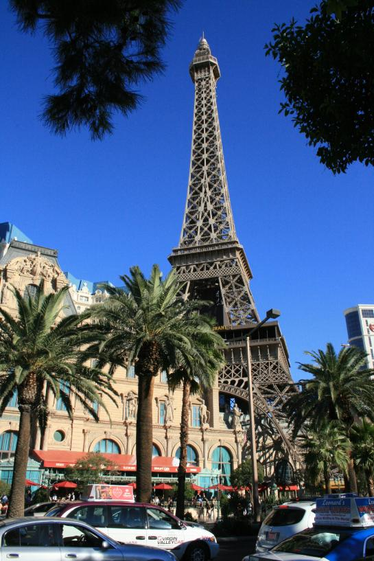 A fake Eiffel Tower in front of palm trees at the Paris Casino in Las Vegas.