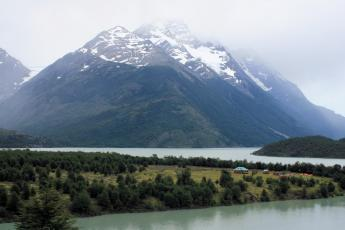 Mountains shrouded in fog behind Refugio Lago Paine in Chilean Patagonia's Torres del Paine National Park.