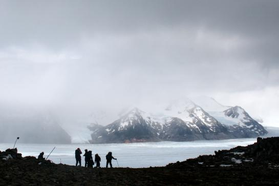 Hikers admire the view of Glaciar Grey on the Torres del Paine Circuit in Chilean Patagonia.