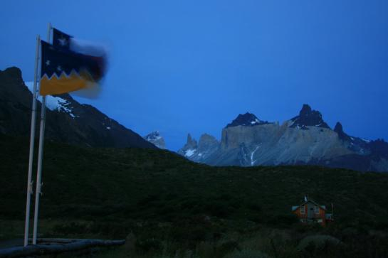 Chilean flags wave at dusk near Paine Grande in Torres del Paine National Park. (photo by Brian Leukart)