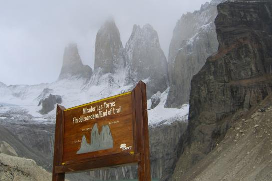 An end-of-trail sign greets hikers below the Torres del Paine in Chilean Patagonia.