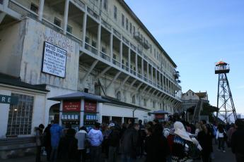 A sign welcomes tourists to Alcatraz off the coast of San Francisco, Calif.