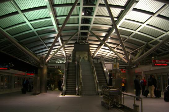 Signs for the Blue Line (left) and Red Line (right) in an AirTrain terminal at the San Francisco International Airport.