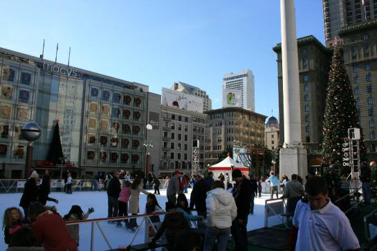Couples skate at the Union Square Holiday Ice Rink in downtown San Francisco.