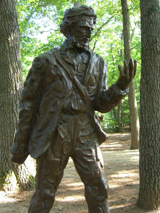 A statue of Henry David Thoreau stands near Walden Pond.