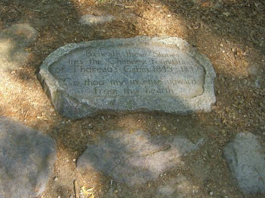 A stone marks the original site of Thoreau's cabin near Walden Pond.