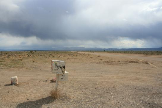 The famous Black Mailbox (now white) sits adjacent to a dirt road leading to the boundary of Area 51.