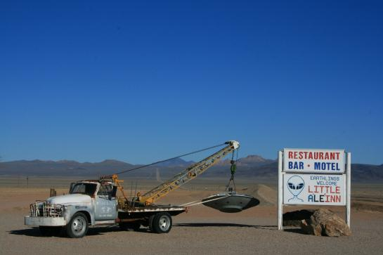 A vintage tow truck carries a flying saucer outside the Little A'le'inn motel in Rachel, Nevada.