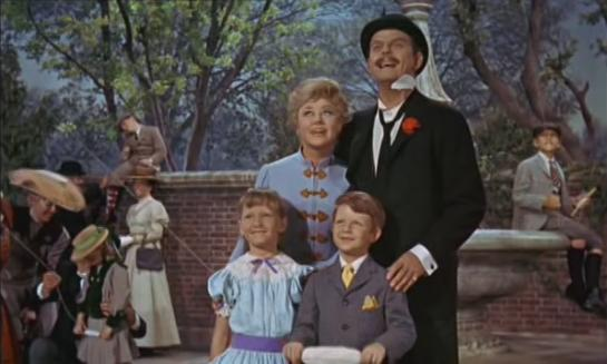 The Banks family looks happy when flying a kite in Mary Poppins.