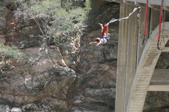 A bungee jumper flips off the Bridge to Nowhere.