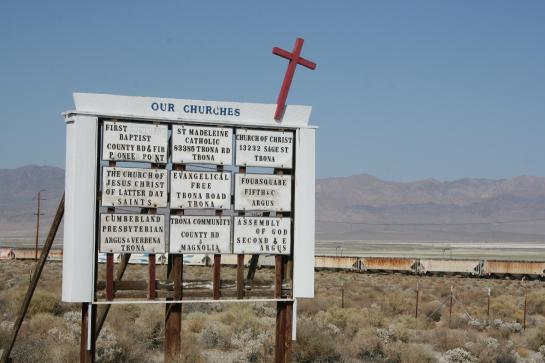 "Trona, California's ""Our Churches"" sign advertises nine churches for its 1,900 residents."