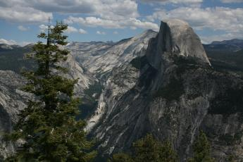 A view of Half Dome in the Yosemite Valley, seen from Glacier Point