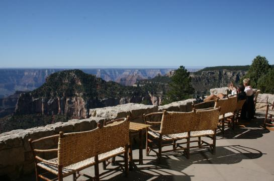 Tourists enjoy the view of the Grand Canyon on the patio at the North Rim Lodge.