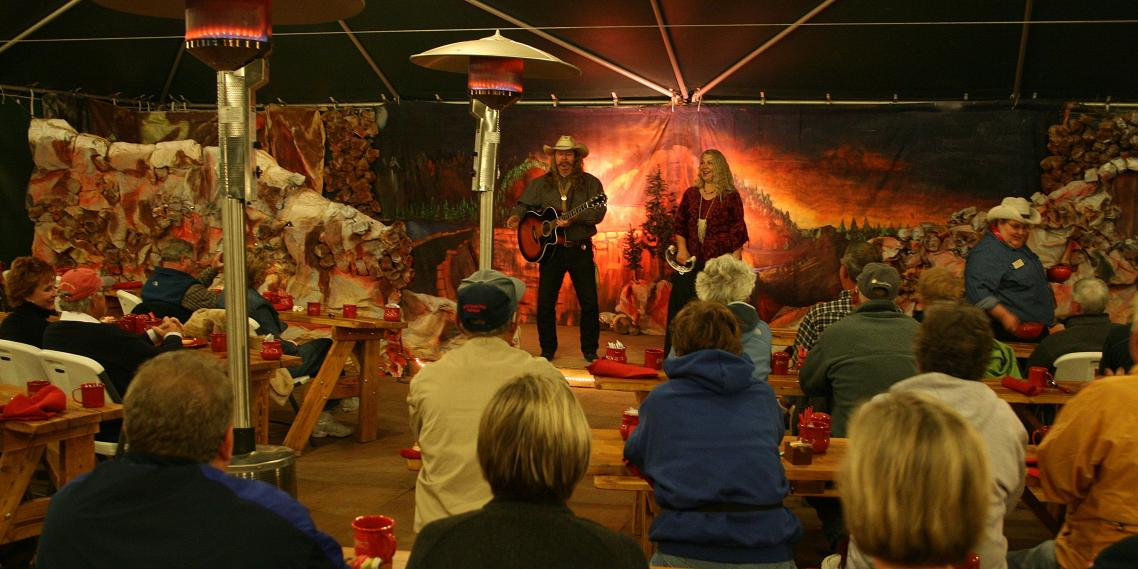 Woodie and Cleta-Jane Cochran entertain guests at the Grand Canyon Cookout Experience on the North Rim.