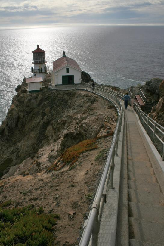 The Point Reyes Lighthouse sits at the bottom of a long staircase on the edge of the Pacific Ocean.
