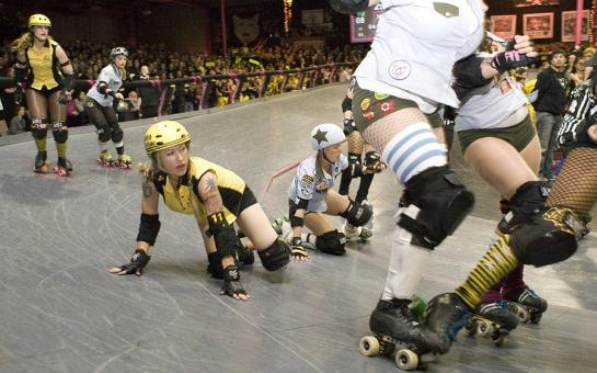 The championship bout between The Tough Cookies and The Swarm heats up as athletes fall to the track floor. (photo by Michael Zampelli)