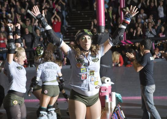 "Tough Cookies blocker ""LEGacy"" celebrates her team's win after the LA Derby Dolls 2009 championship game. (photo by Michael Zampelli)"
