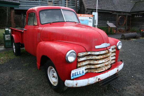 Bella's red, 1953 Chevrolet pickup truck sits outside the Forks Chamber of Commerce.
