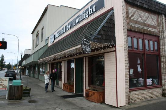 Tourists walk outside the Dazzled by Twilight store in Forks, Washington.