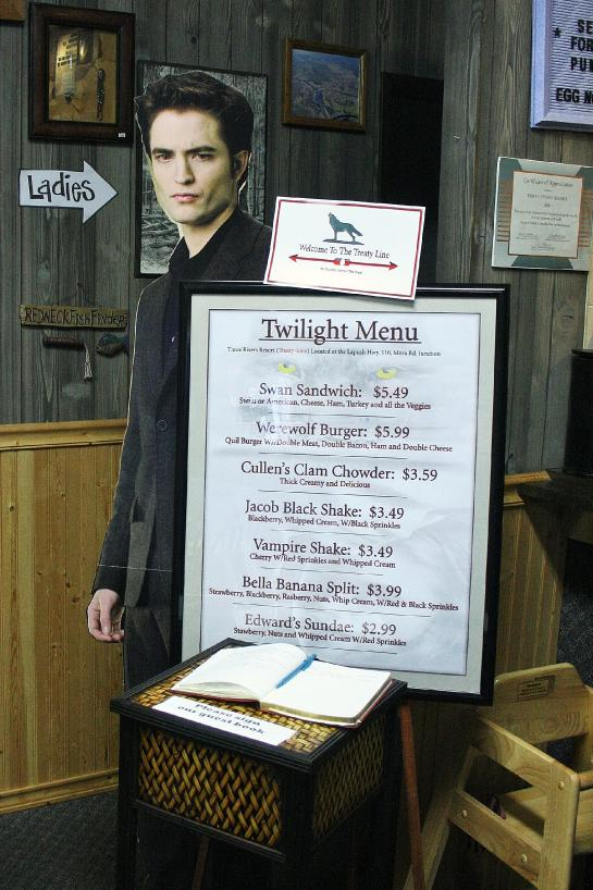 A cardboard cutout of Edward Cullen (a.k.a. Robert Pattinson) stands behind a restaurant menu in Forks, Washington.