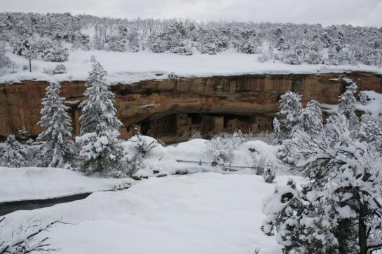 Spruce Tree House sits below a snow-covered cliff in Mesa Verde National Park.