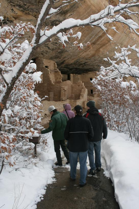 Ranger Craig guides Park visitors toward Spruce Tree House in Mesa Verde National Park.