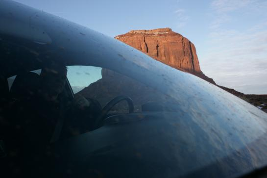 Rich steers our car through a muddy windshield in Monument Valley.