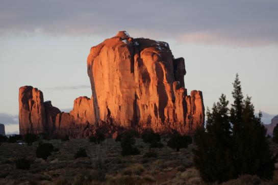 Sun reflects off a butte in Monument Valley.