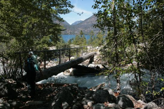 A hiker readies to cross Prince Creek near Lake Chelan.