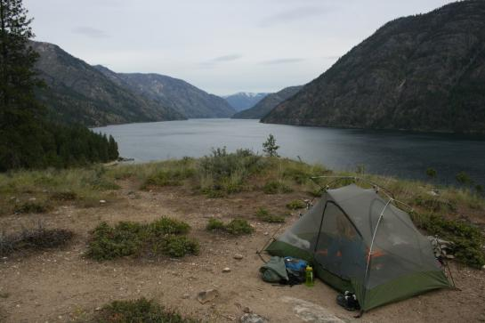 A tent sits on a ridge above Lake Chelan.