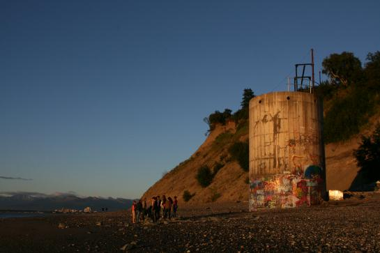Teenagers congregate at night on the beach at Point Woronzof near the Coastal Trail in Anchorage, Alaska.