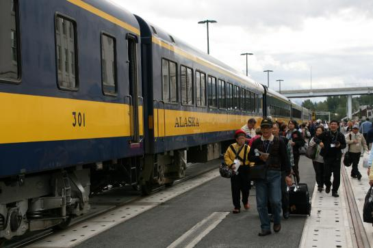 Japanese tourists prepare to board the Alaska Railroad in Anchorage, Alaska.
