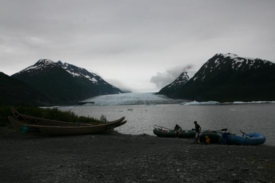 Rafts and canoes sit in front of Spencer Glacier in Alaska's Chugach National Forest.