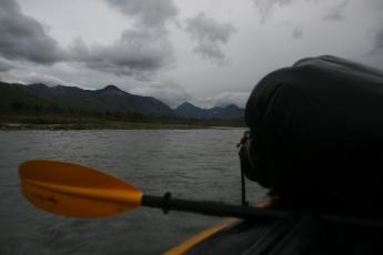 Clouds gather over Denali's Sanctuary River during a packrafting trip.
