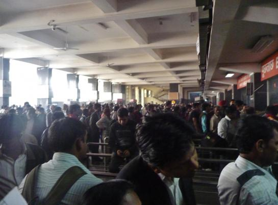 Passengers flood the New Delhi train station.