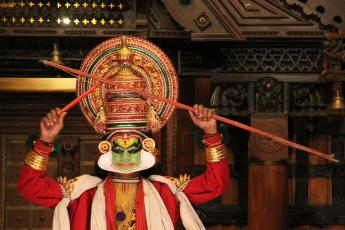 An actor wearing elaborate makeup performs Kathakali in Fort Cochin, India.