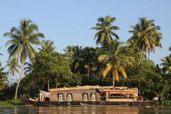 A houseboat sits on the Backwaters in Kerala, India.